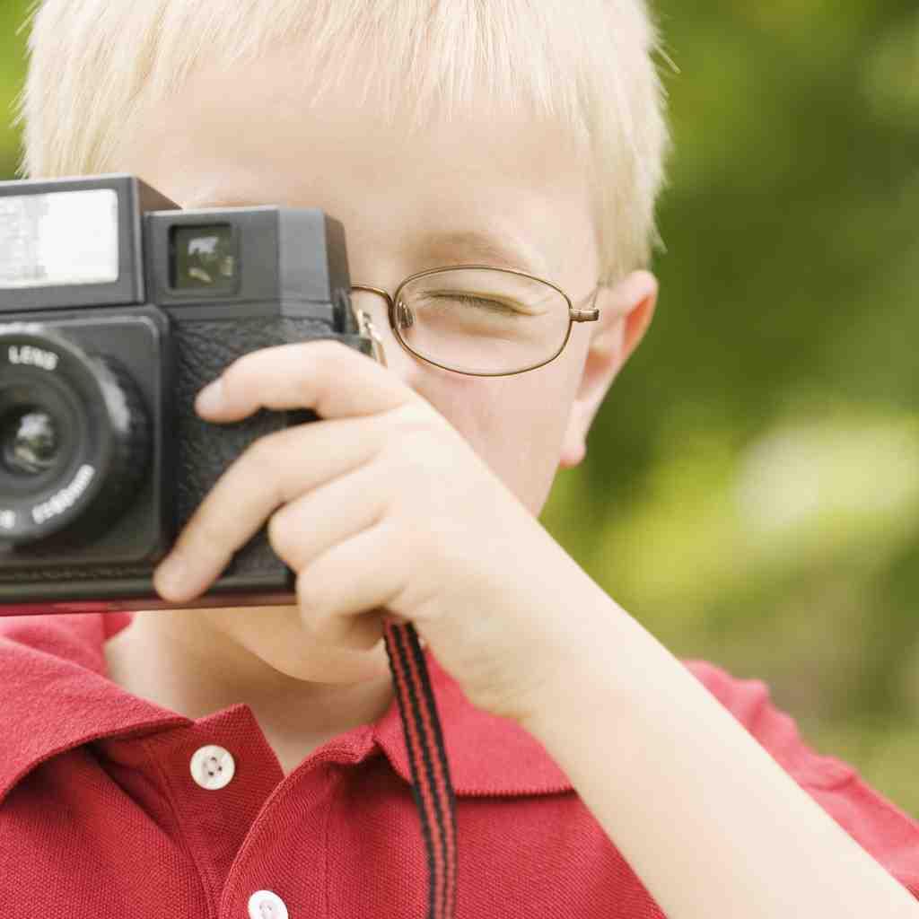 niño cámara fotos